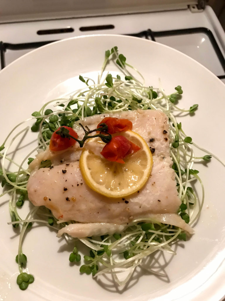 Butter and Lemon Baked Basa Fillet with Tomatoes